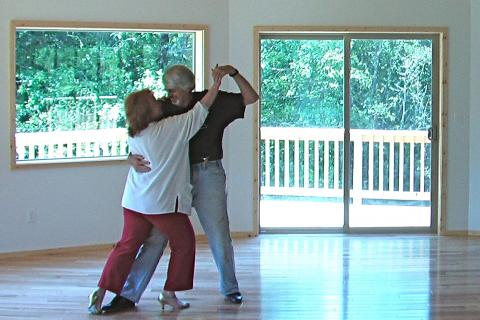 """Susan & Eric dancing in their """"Tango Palace"""""""